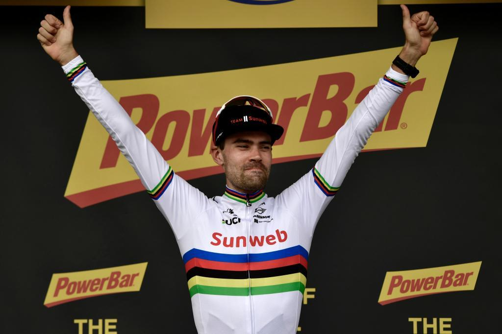 Netherlands Tom <HIT>Dumoulin</HIT> celebrates on the podium after winning the 20th stage of the 105th edition of the Tour de France cycling race, a 31-kilometer individual time-trial between Saint-Pee-sur-Nivelle and Espelette, southwestern France, on July 28, 2018. / AFP PHOTO / Philippe LOPEZ