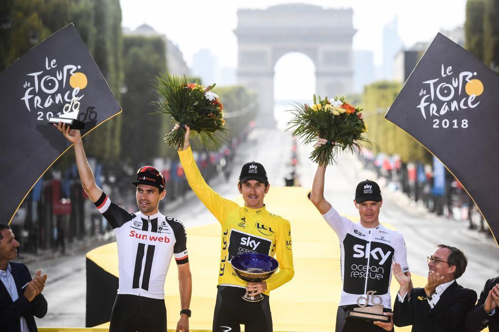 Tour de France 2018 winner Great Britains Geraint Thomas (C), wearing the overall leaders yellow jersey, second-placed Netherlands Tom <HIT>Dumoulin</HIT> (L) and third-placed Great Britains Christopher Froome (R) celebrate on the podium after the 21st and last stage of the 105th edition of the Tour de France cycling race between Houilles and Paris Champs-Elysees, on July 29, 2018. / AFP PHOTO / POOL / STEPHANE MANTEY
