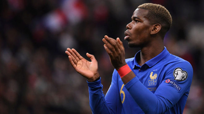 Paul Pogba applauding the supporters whilst playing for France.