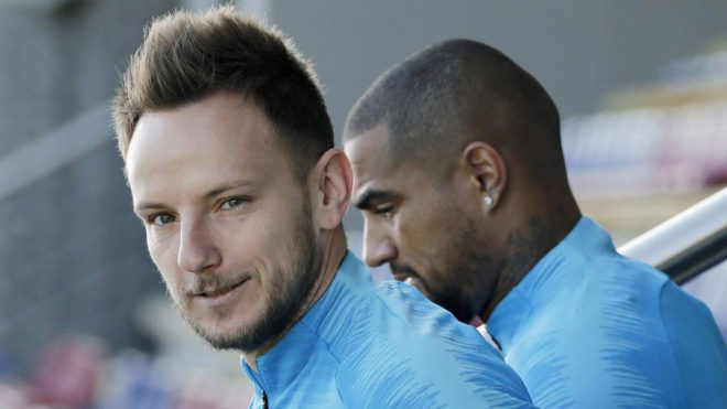 Rakitic at Barcelona's training ground, alongside Kevin-Prince...