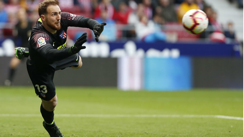Oblak making a save during a match.