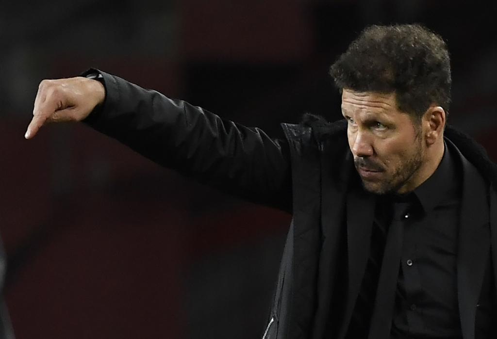 Diego Simeone giving out instructions to his players.