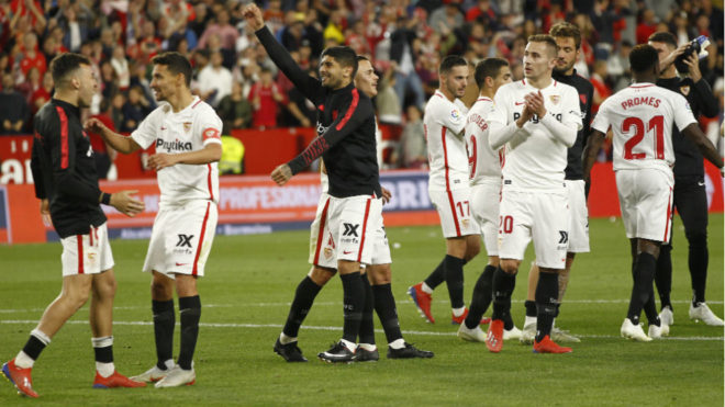 Sevilla celebrate after their derby win.