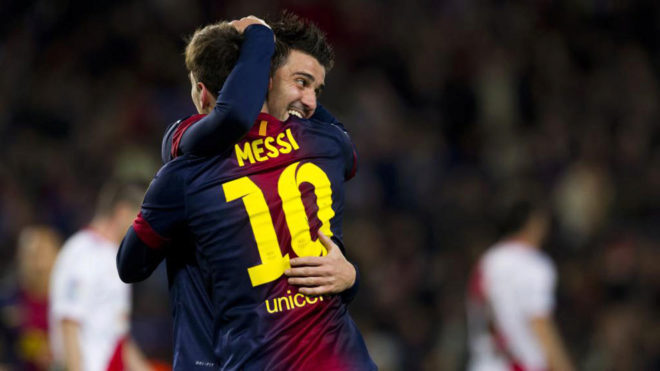 David Villa hugs Lionel Messi