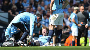 De Bruyne being treated by the Manchester City medical team.