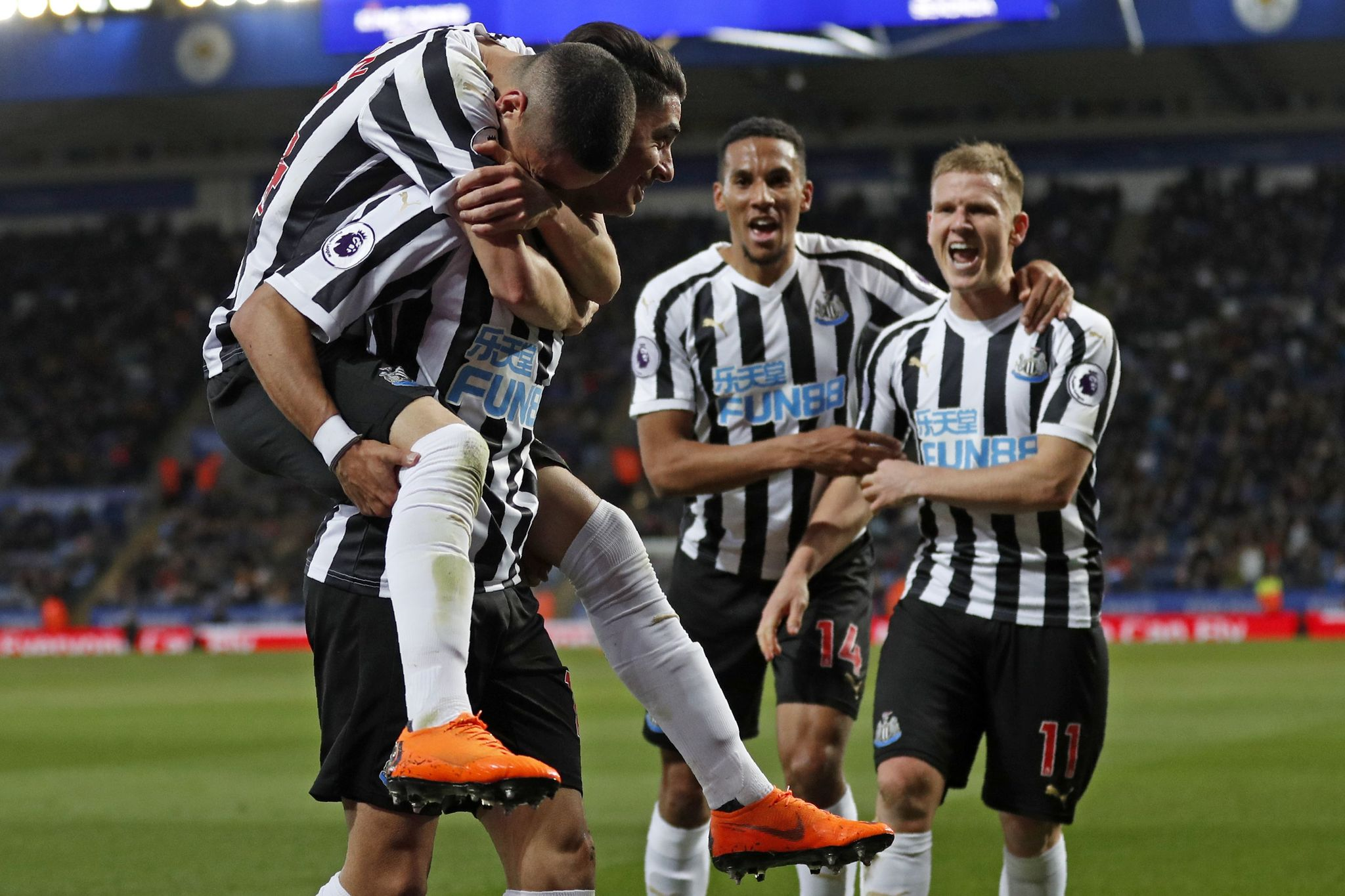 Newcastle Uniteds Spanish striker <HIT>Ayoze</HIT> Perez (2nd L) celebrates with teammates after scoring the opening goal of the English Premier League football match between Leicester City and Newcastle United at King Power Stadium in Leicester, central England on April 12, 2019. (Photo by Adrian DENNIS / AFP) / RESTRICTED TO EDITORIAL USE. No use with unauthorized audio, video, data, fixture lists, club/league logos or live services. Online in-match use limited to 120 images. An additional 40 images may be used in extra time. No video emulation. Social media in-match use limited to 120 images. An additional 40 images may be used in extra time. No use in betting publications, games or single club/league/player publications. /