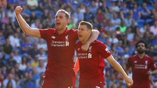 James Milner celebrates his goal from the penalty spot.