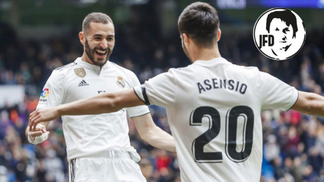 Asensio hugs Benzema after the Frenchman's first goal.