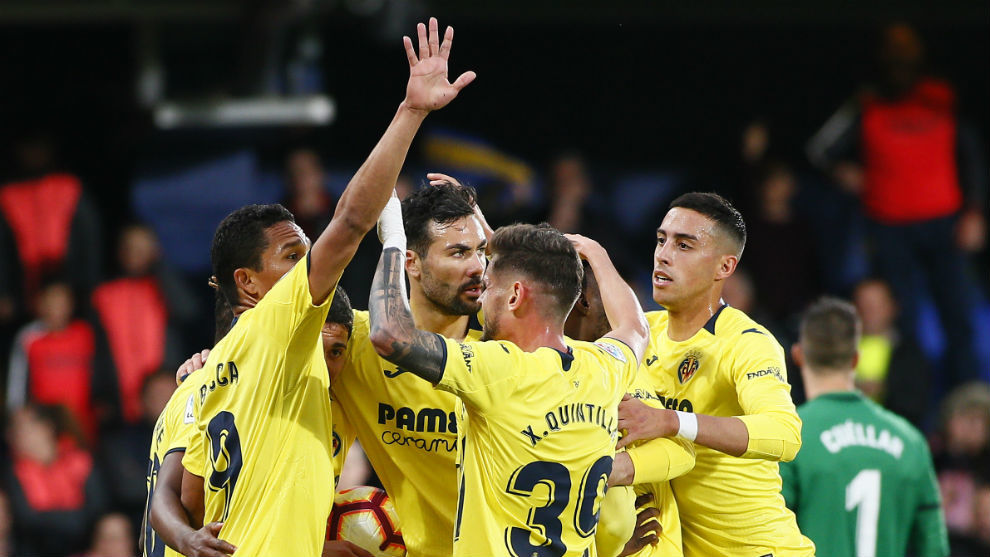 The Villarreal players celebrate their first goal.