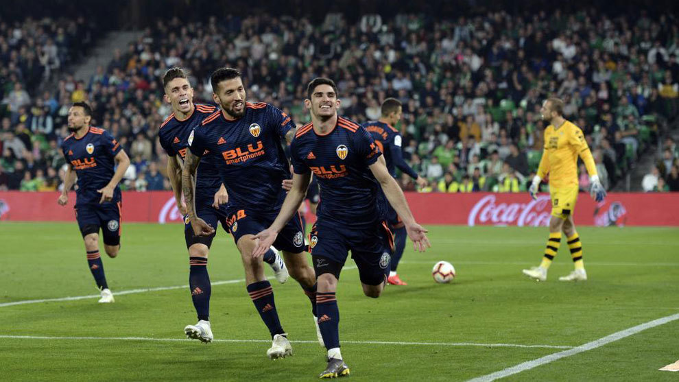 Guedes celebrating his second goal.