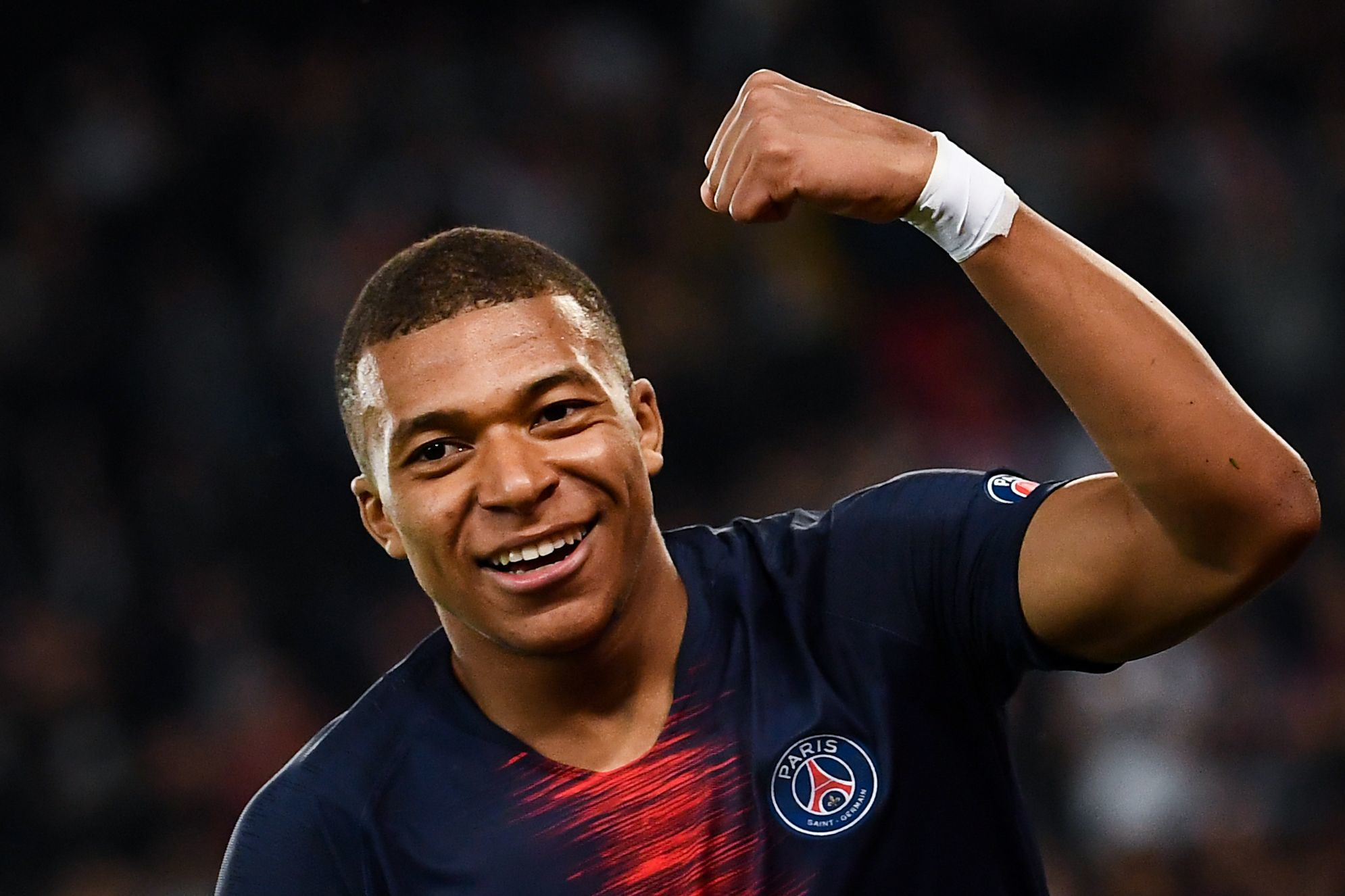 Paris Saint-Germains French forward Kylian <HIT>Mbappe</HIT> celebrates after scoring a goal during the French L1 football match between Paris Saint-Germain (PSG) and Monaco (ASM) on April 21, 2019 at the Parc des Princes stadium in Paris. (Photo by Anne-Christine POUJOULAT / AFP)