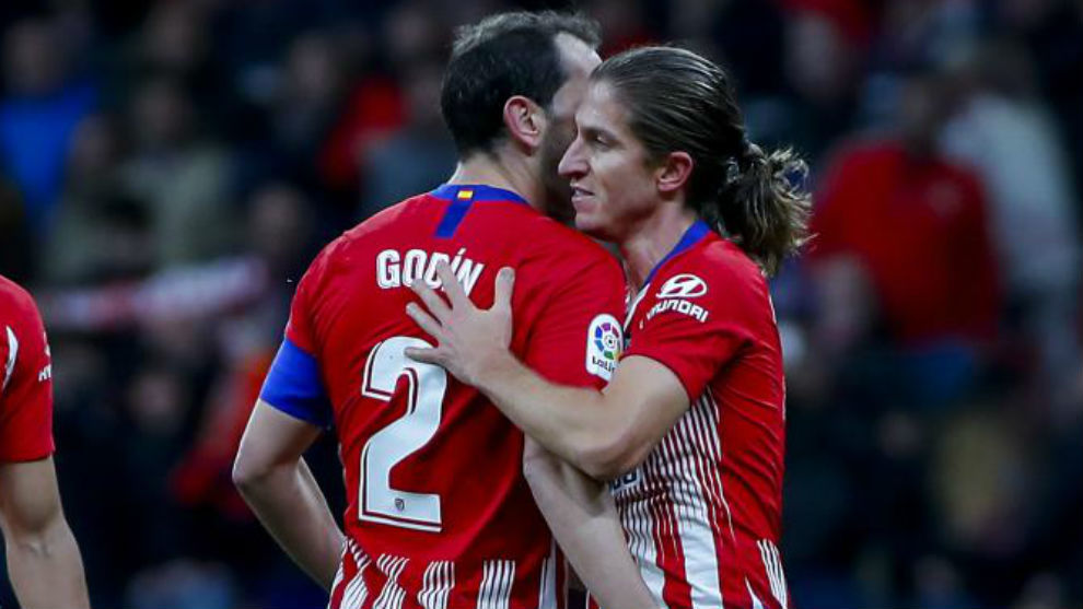 Godín and Filipe Luis.