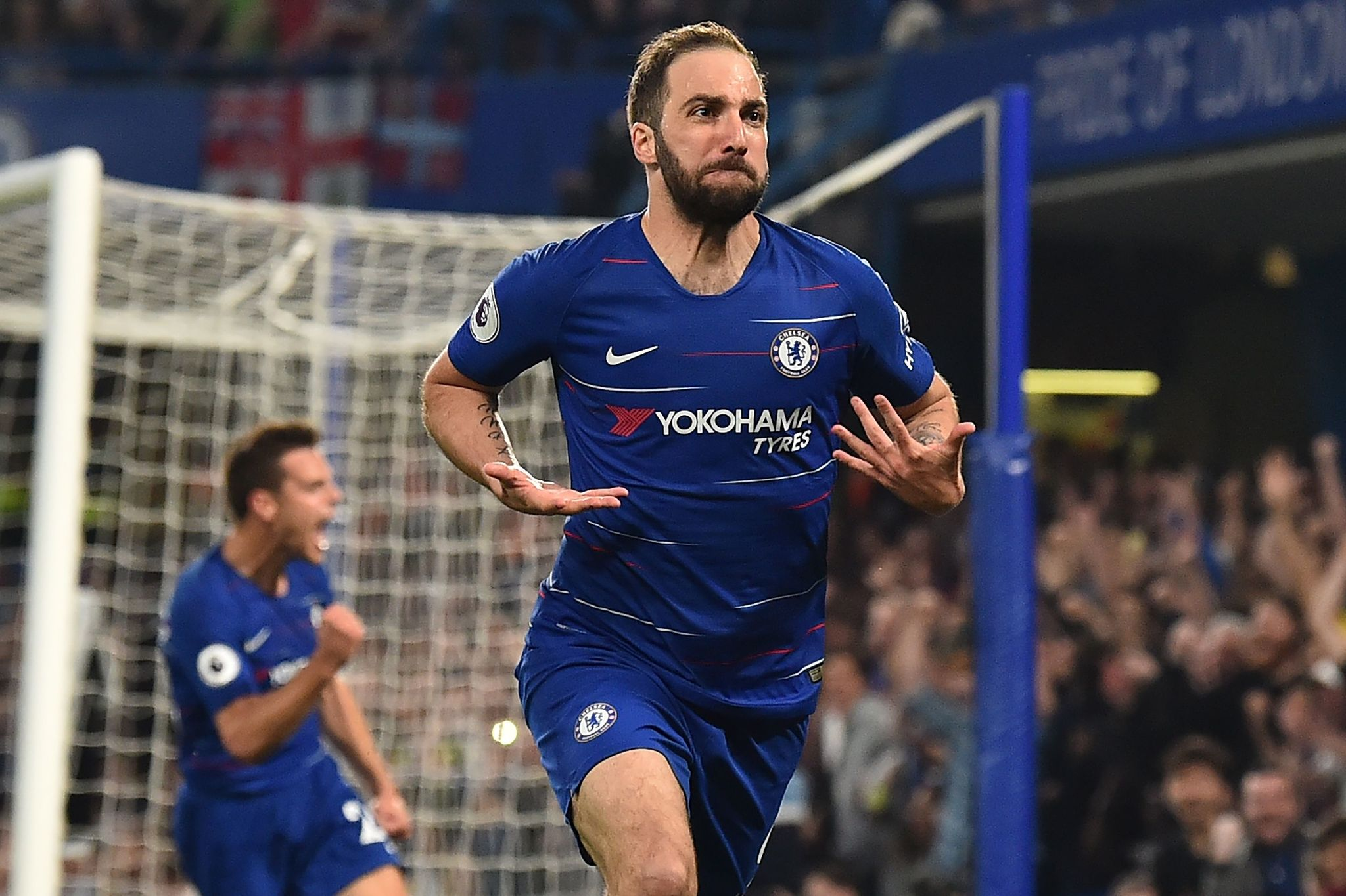 Chelseas Argentinian striker Gonzalo <HIT>Higuain</HIT> celebrates after scoring their second goal during the English Premier League football match between Chelsea and Burnley at Stamford Bridge in London on April 22, 2019. (Photo by Glyn KIRK / AFP) / RESTRICTED TO EDITORIAL USE. No use with unauthorized audio, video, data, fixture lists, club/league logos or live services. Online in-match use limited to 120 images. An additional 40 images may be used in extra time. No video emulation. Social media in-match use limited to 120 images. An additional 40 images may be used in extra time. No use in betting publications, games or single club/league/player publications. /