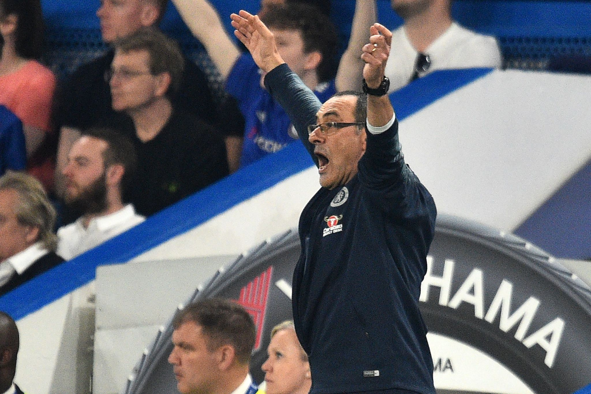 Chelseas Italian head coach Maurizio <HIT>Sarri</HIT> gestures on the touchline during the English Premier League football match between Chelsea and Burnley at Stamford Bridge in London on April 22, 2019. (Photo by Glyn KIRK / AFP) / RESTRICTED TO EDITORIAL USE. No use with unauthorized audio, video, data, fixture lists, club/league logos or live services. Online in-match use limited to 120 images. An additional 40 images may be used in extra time. No video emulation. Social media in-match use limited to 120 images. An additional 40 images may be used in extra time. No use in betting publications, games or single club/league/player publications. /
