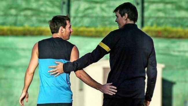 Messi and Tito during a training session.