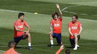 Rodri, Griezmann y Filipe Luis durante el entrenamiento del Atlético.