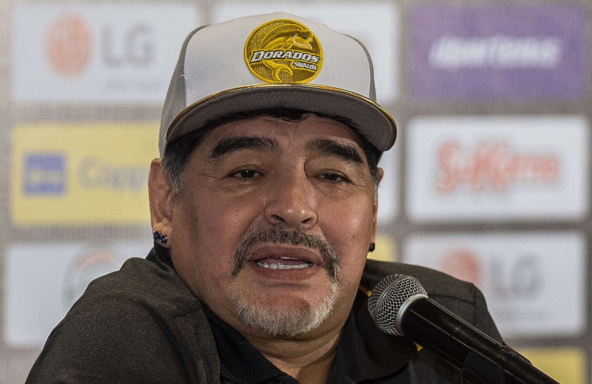 (FILES) In this file photo taken on September 10, 2018 Argentine legend Diego <HIT>Maradona</HIT> gives a press conference during his presentation as the new coach of Mexican football club Dorados, in Culiacan, Sinaloa State, Mexico. - Argentine legend Diego <HIT>Maradona</HIT> remained hospitalized on January 04, 2019 in Buenos Aires after a scheduled medical check up. According to local press, his condition is not serious. (Photo by Pedro PARDO / AFP)