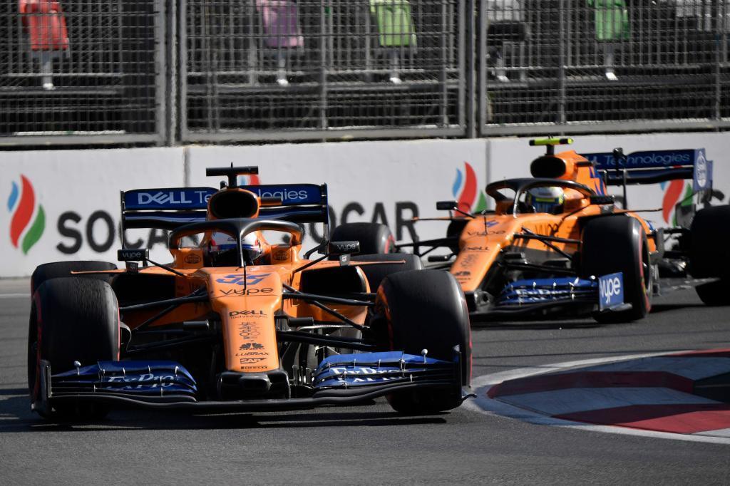 McLarens Spanish driver Carlos <HIT>Sainz</HIT> Jr and McLarens British driver Lando Norris steer their cars during the Formula One Azerbaijan Grand Prix at the Baku City Circuit in Baku on April 28, 2019. (Photo by Alexander NEMENOV / AFP)