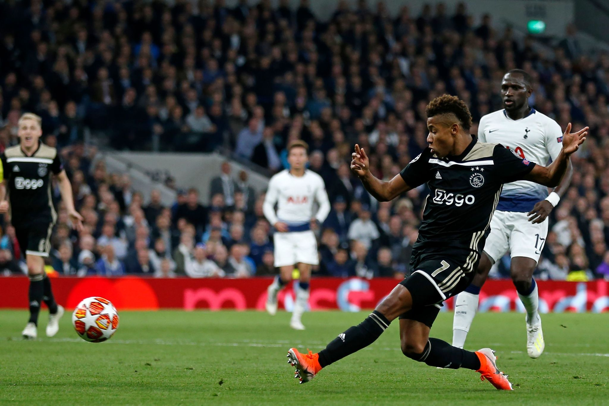Ajaxs Brazilian striker <HIT>David</HIT><HIT>Neres</HIT> sees this shot come back off the post during the UEFA Champions League semi-final first leg football match between Tottenham Hotspur and Ajax at the Tottenham Hotspur Stadium in north London, on April 30, 2019. (Photo by Ian KINGTON / IKIMAGES / AFP)
