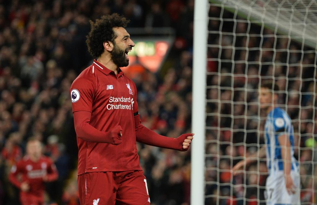 Liverpool (United Kingdom), 26/04/2019.- Liverpools Mohamed <HIT>Salah</HIT> celebrates scoring a <HIT>goal</HIT> during the English Premier League match between Liverpool FC and Huddersfield at Anfield, Liverpool, Britain, 26 April 2019. (Reino Unido) EFE/EPA/PETER POWELL EDITORIAL USE ONLY. No use with unauthorized audio, video, data, fixture lists, club/league logos or live services. Online in-match use limited to 120 images, no video emulation. No use in betting, games or single club/league/player publications