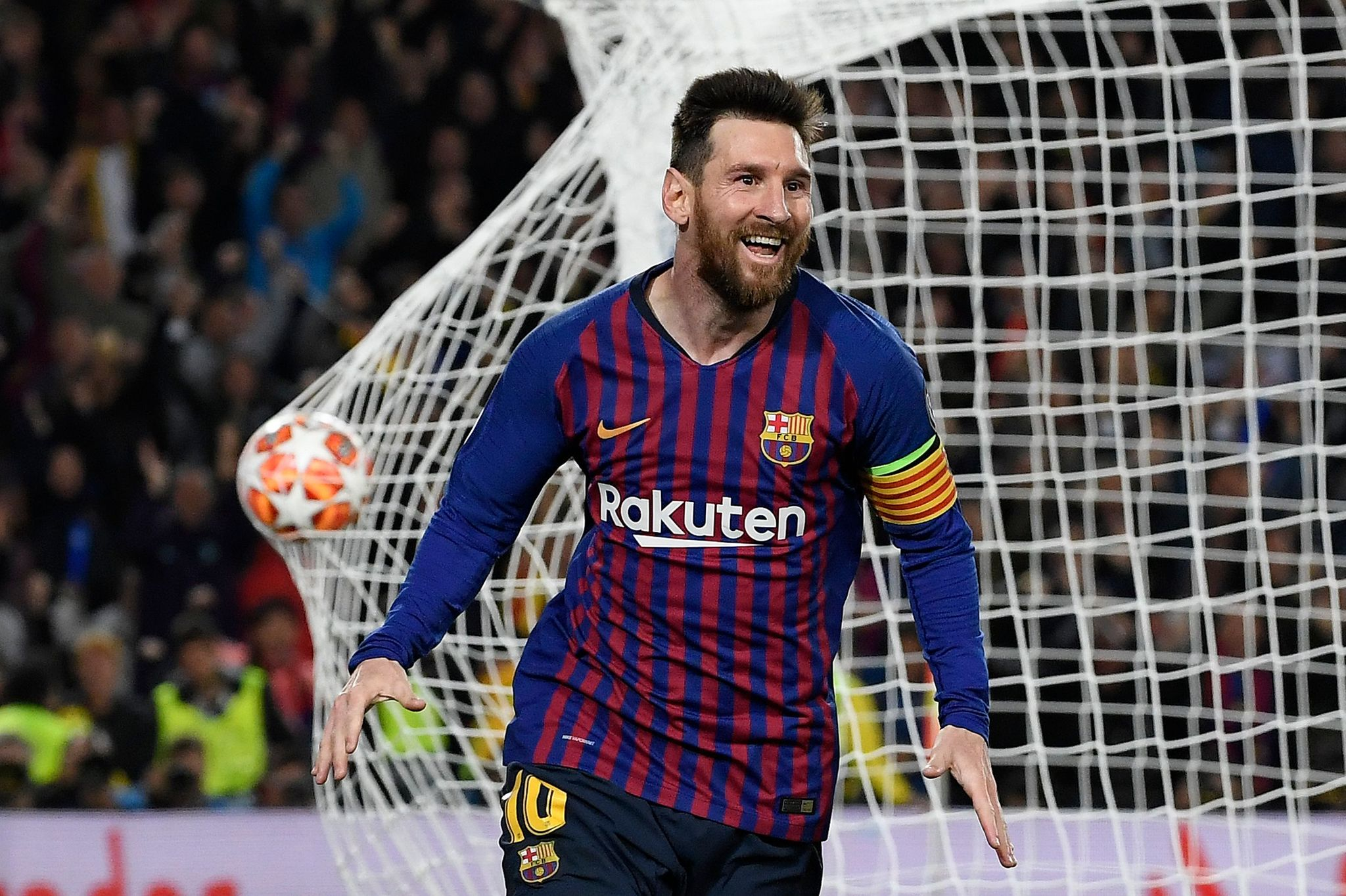 TOPSHOT - Barcelonas Argentinian forward Lionel <HIT>Messi</HIT> celebrates after scoring a <HIT>goal</HIT> during the UEFA Champions League semi-final first leg football match between Barcelona and Liverpool at the Camp Nou Stadium in Barcelona on May 1, 2019. (Photo by LLUIS GENE / AFP)