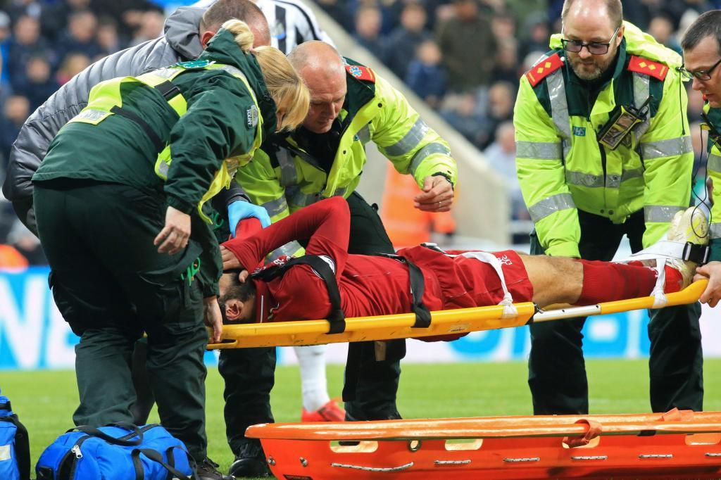 Liverpools Egyptian midfielder Mohamed <HIT>Salah</HIT> reacts as he is placed on a stretcher after injuring himself in a challenge with Newcastle Uniteds Slovakian goalkeeper Martin Dubravka (not pictured) during the English Premier League football match between Newcastle United and Liverpool at St James Park in Newcastle-upon-Tyne, north east England on May 4, 2019. (Photo by Lindsey PARNABY / AFP) / RESTRICTED TO EDITORIAL USE. No use with unauthorized audio, video, data, fixture lists, club/league logos or live services. Online in-match use limited to 120 images. An additional 40 images may be used in extra time. No video emulation. Social media in-match use limited to 120 images. An additional 40 images may be used in extra time. No use in betting publications, games or single club/league/player publications. /
