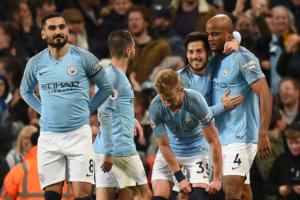 Manchester <HIT>City</HIT>s Belgian defender Vincent Kompany (R) celebrates scoring the opening goal during the English Premier League football match between Manchester <HIT>City</HIT> and Leicester <HIT>City</HIT> at the Etihad Stadium in Manchester, north west England, on May 6, 2019. (Photo by Oli SCARFF / AFP) / RESTRICTED TO EDITORIAL USE. No use with unauthorized audio, video, data, fixture lists, club/league logos or live services. Online in-match use limited to 120 images. An additional 40 images may be used in extra time. No video emulation. Social media in-match use limited to 120 images. An additional 40 images may be used in extra time. No use in betting publications, games or single club/league/player publications. /