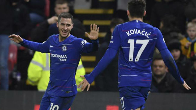 Eden Hazard and Mateo Kovacic celebrate a goal for Chelsea.