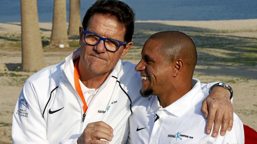 Fabio Capello junto a Roberto Carlos.