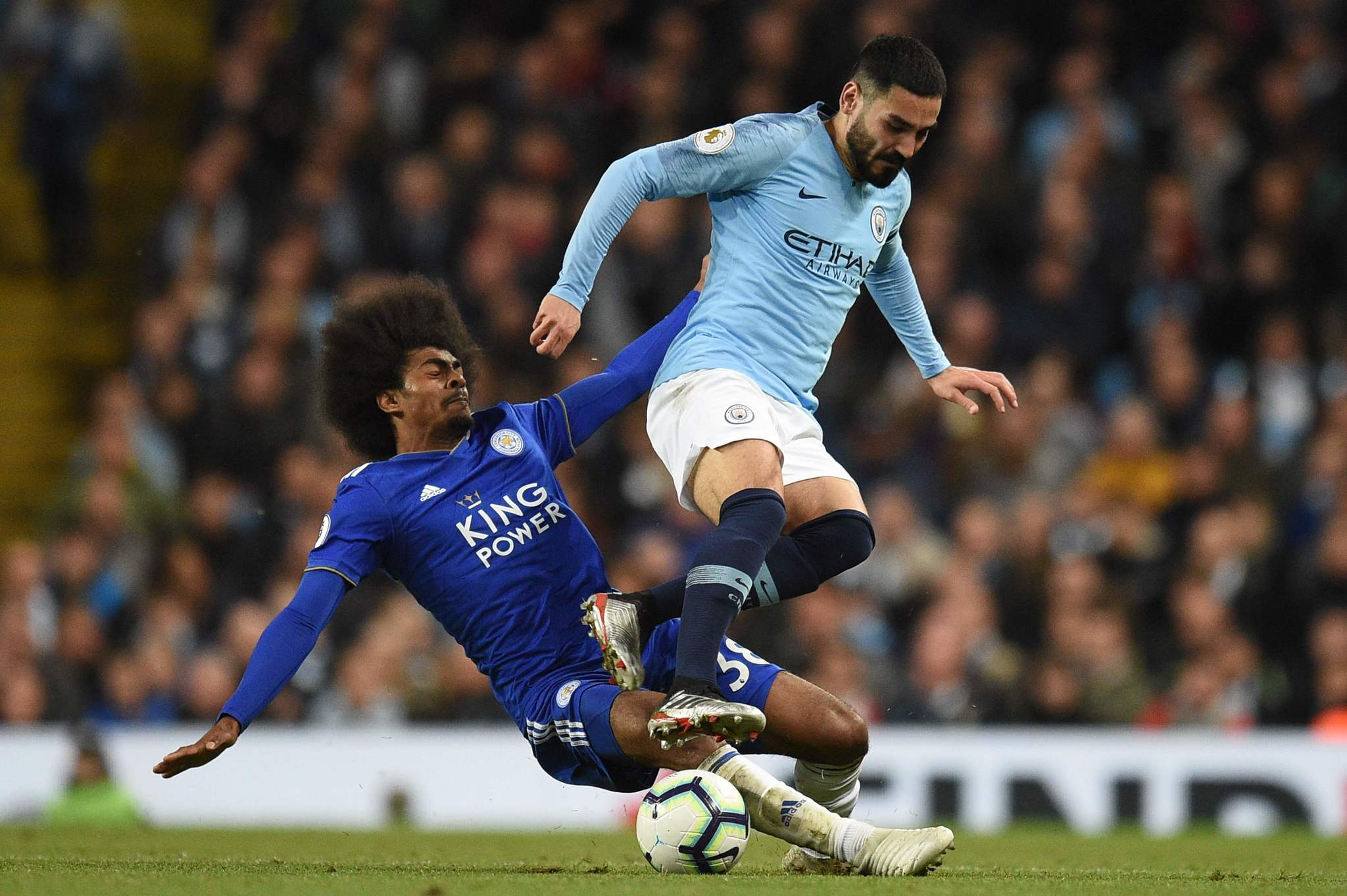 Leicester Citys English midfielder Hamza Choudhury (L) tackles Manchester Citys German midfielder Ilkay <HIT>Gundogan</HIT> (R) during the English Premier League football match between Manchester City and Leicester City at the Etihad Stadium in Manchester, north west England, on May 6, 2019. (Photo by Oli SCARFF / AFP) / RESTRICTED TO EDITORIAL USE. No use with unauthorized audio, video, data, fixture lists, club/league logos or live services. Online in-match use limited to 120 images. An additional 40 images may be used in extra time. No video emulation. Social media in-match use limited to 120 images. An additional 40 images may be used in extra time. No use in betting publications, games or single club/league/player publications. /