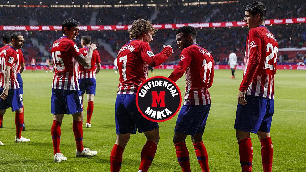 Griezmann celebra un gol con Lemar