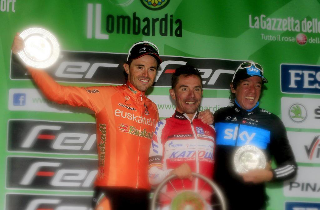 Spanish cyclist Joaquim Rodriguez (C) of Team Katusha, Spanish second placed <HIT>Samuel</HIT><HIT>Sanchez</HIT> (L) and Colombian third placed Rigoberto Uran Uran (R) celebrate on September 29, 2012 on podium after the 106th Giro di Lombardia (Tour of Lombardy), 251kms race from Bergamo to Lecco. AFP PHOTO / LUK BENIES