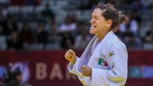 Lenia celebra la victoria por la medalla de oro
