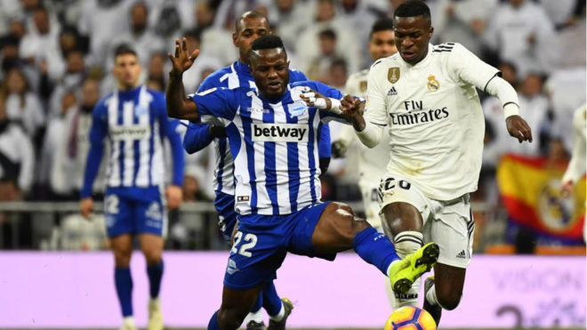 Wakaso pushes for the ball against Vinicius.