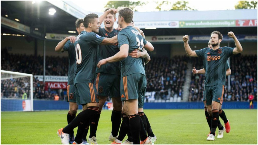 The Ajax players celebrate Lasse Schone's goal.
