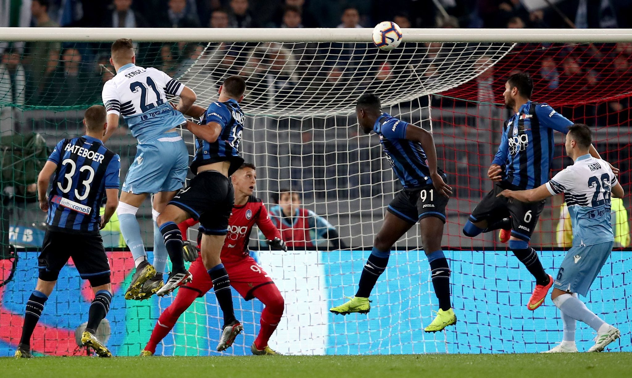 <HIT>Lazio</HIT>s Serbian midfielder Sergej Milinkovic-Savic heads and scores a goal during the Italian Tim Cup final match between <HIT>Lazio</HIT> and Atalanta, on May 15, 2019 at the Olympic Stadium in Rome. (Photo by Isabella BONOTTO / AFP)