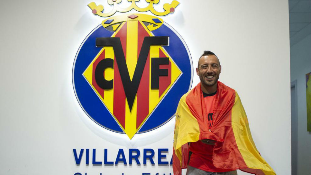 Santi Cazorla posing in front of Villarreal's badge with the Spanish...