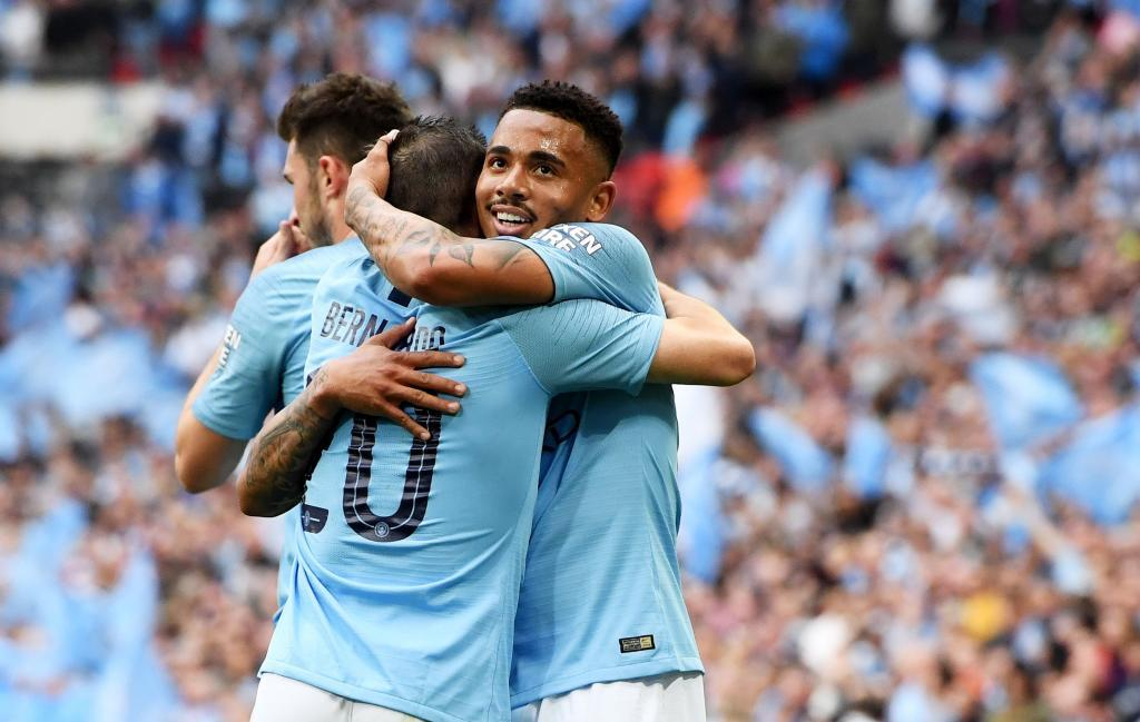 London (United Kingdom), 18/05/2019.- <HIT>Gabriel</HIT><HIT>Jesus</HIT> (R facing) of Manchester City celebrates with teammates after scoring the 2-0 during the English FA Cup final between Manchester City and Watford at Wembley Stadium in London, Britain, 18 May 2019. (Reino Unido, Londres) EFE/EPA/FACUNDO ARRIZABALAGA EDITORIAL USE ONLY. No use with unauthorized audio, video, data, fixture lists, club/league logos or live services. Online in-match use limited to 120 images, no video emulation. No use in betting, games or single club/league/player publications