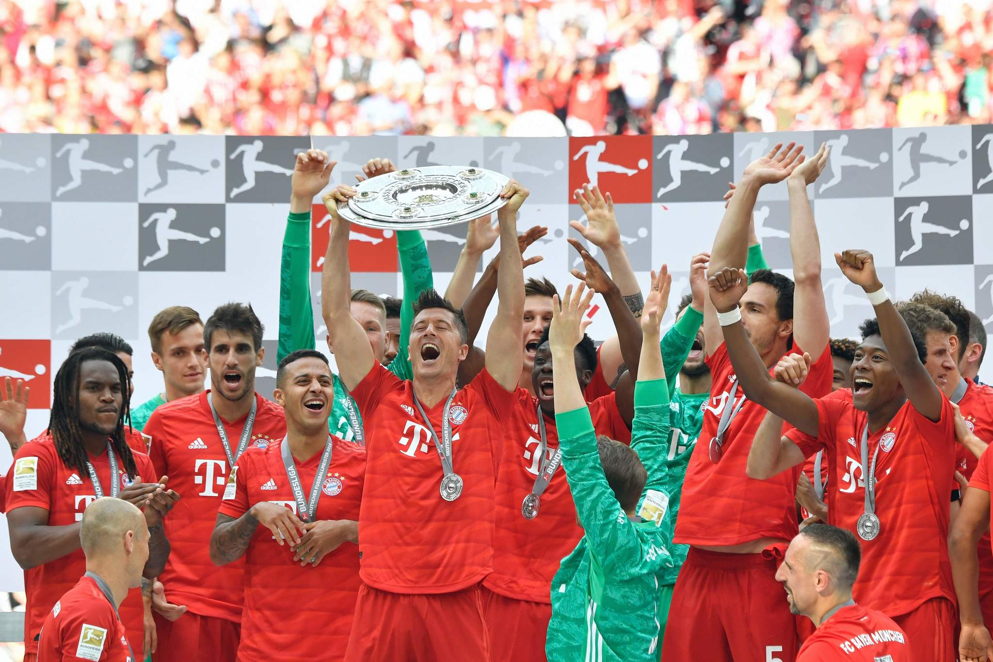 Bayern Munich players including Bayern Munichs Polish forward Robert <HIT>Lewandowski</HIT> celebrate with the trophy after the German First division Bundesliga football match FC Bayern Munich v Eintracht Frankfurt in Munich, southern Germany, on May 18, 2019. (Photo by John MACDOUGALL / AFP) / DFL REGULATIONS PROHIBIT ANY USE OF PHOTOGRAPHS AS IMAGE SEQUENCES AND/OR QUASI-VIDEO