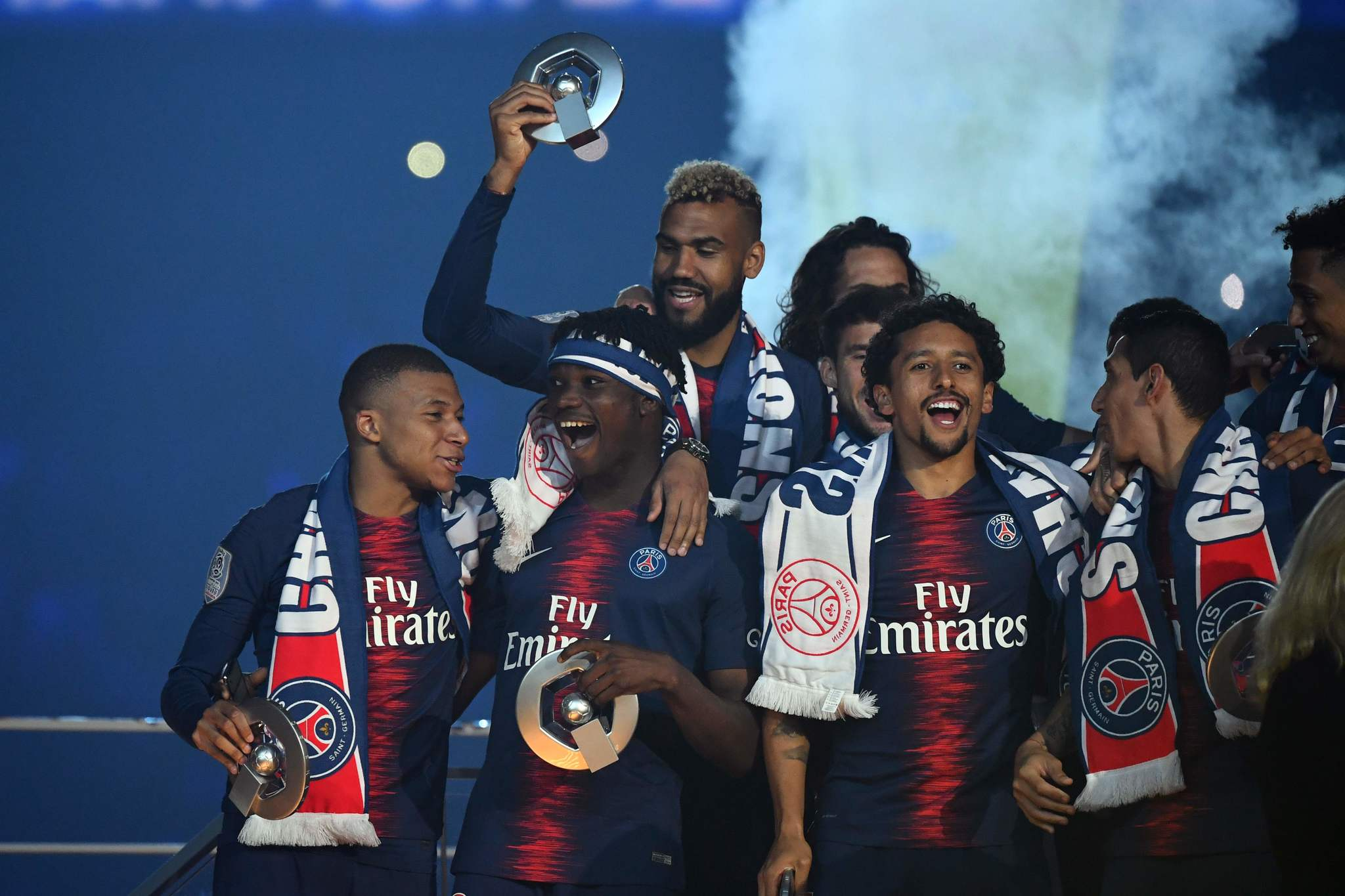 Paris Saint-Germains French forward Kylian <HIT>Mbappe</HIT> celebrates with their champions trophies at the end of the French L1 football match between Paris Saint-Germain (PSG) and Dijon at the Parc des Princes stadium in Paris on May 18, 2019. (Photo by FRANCK FIFE / AFP)
