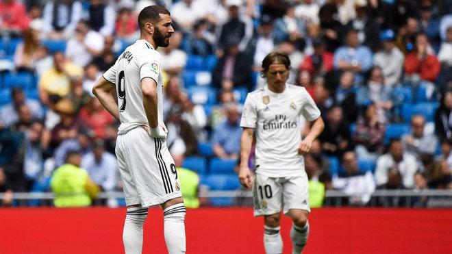 Karim Benzema and Luka Modric react after Real Betis scored a goal