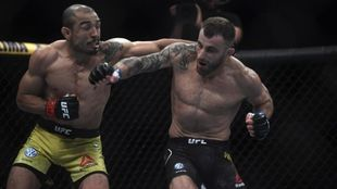 Brazilian fighter Jose Aldo (L) competes against Australian fighter...