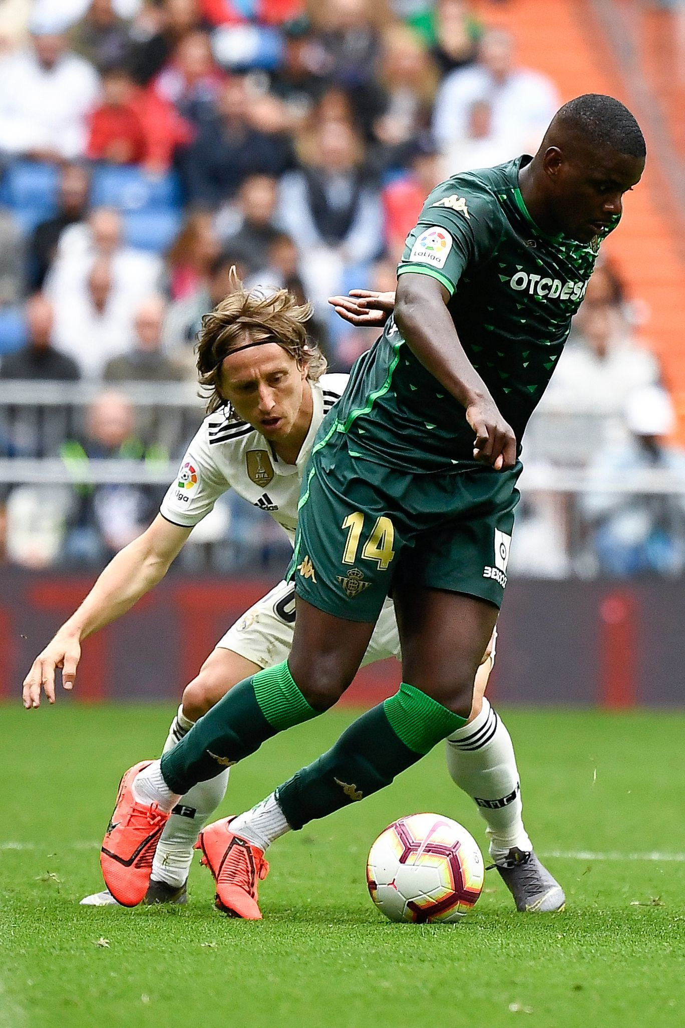 Real Madrids Croatian midfielder Luka Modric (back) challenges Real <HIT>Betis</HIT> Portuguese midfielder <HIT>William</HIT> Carvalho during the Spanish League football match between Real Madrid and Real <HIT>Betis</HIT> at the Santiago Bernabeu stadium in Madrid on May 19, 2019. (Photo by PIERRE-PHILIPPE MARCOU / AFP)