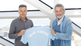 Fran Escriba posing with Celta's shirt alongside club president...