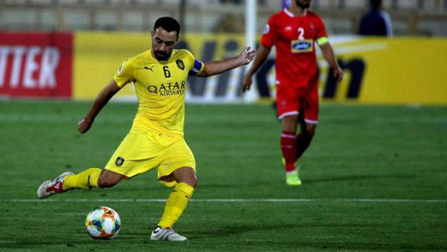 Xavi chuta durante su último partido con Al Sadd.