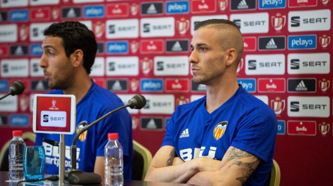 Jaume Domenech sat alongside Valencia captain Dani Parejo.