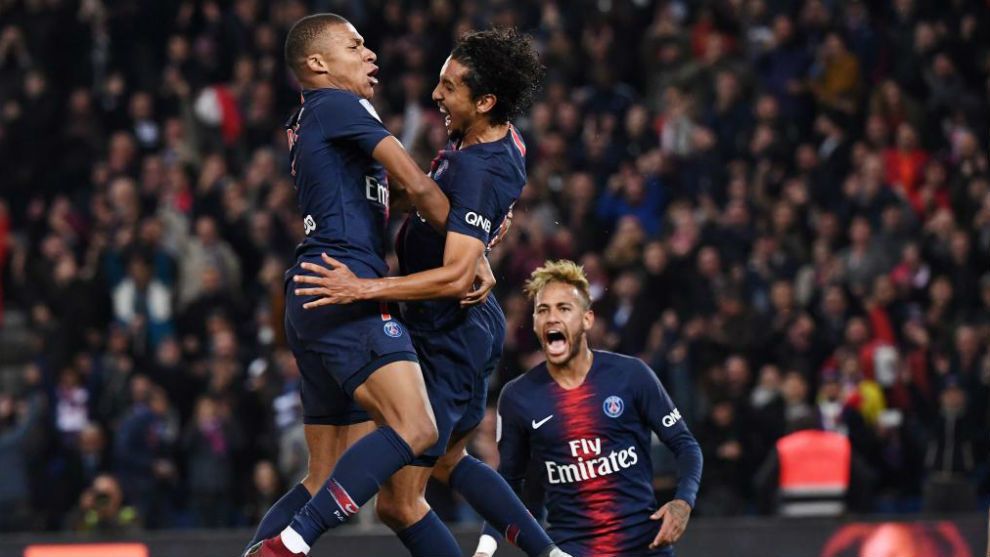 Mbappe celebrates a goal with Marquinhos.