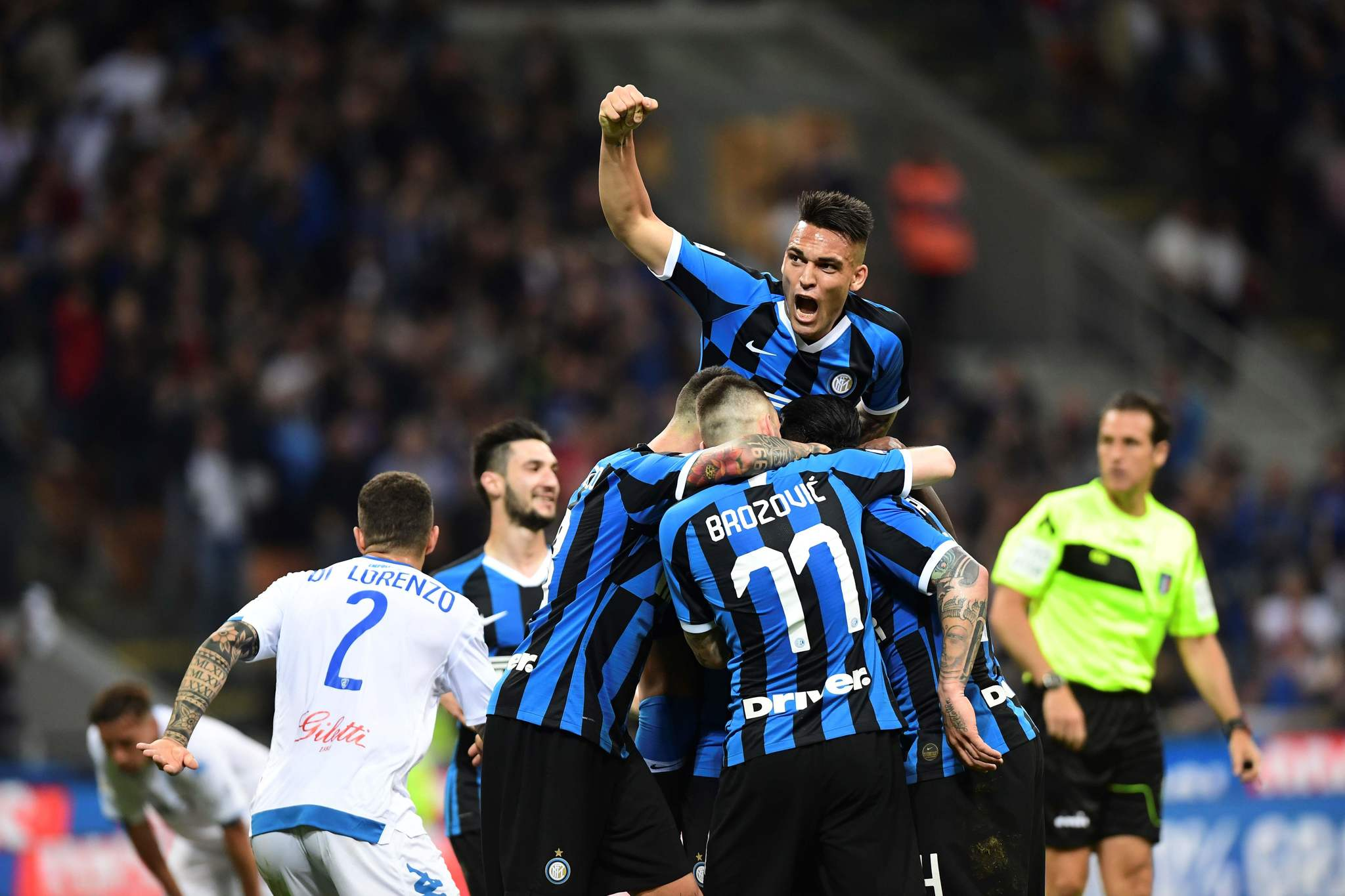 <HIT>Inter</HIT>s Belgium midfielder Radja Nainggolan (not seen) is congratulated by teammates after scoring his team second goal during the Italian Serie A football match between <HIT>Inter</HIT> Milan and Empoli on May 26, 2019 at the San Siro stadium in Milan. (Photo by Miguel MEDINA / AFP)