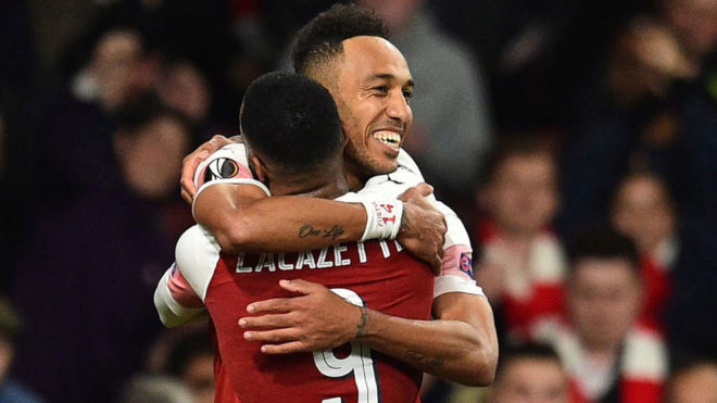 Pierre-Emerick Aubameyang and Alexandre Lacazette celebrate a goal...