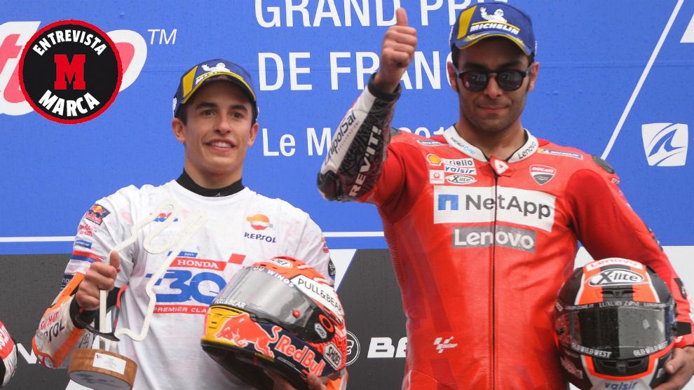 Petrucci, en el podio junto a Márquez.